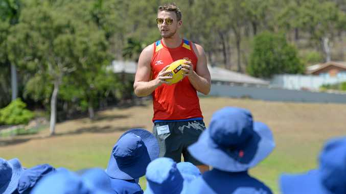 Gold Coast Suns AFL player Trent McKenzie on hand at Frenchville State School for a coaching clinic with Rocky kids.