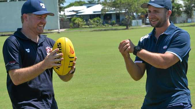AFLQ Mackay's new competition and club development manager Paul Scullie with former regional manager Jeff Neumann.