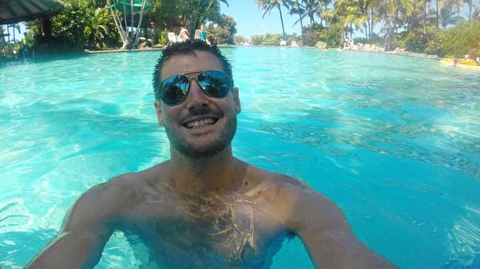 FOUND: David Delforce on his honeymoon on Hamilton Island. Mr Delforce thought his photos were gone forever after his GoPro slipped of his head while diving off Hay Point in 2014.