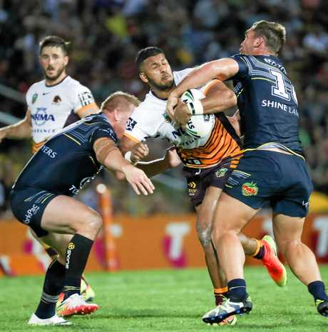 Broncos Jonus Pearson tackled by Cowboys Ben Hannant (left) and Scott Bolton  (right) during the NRL Elimination Final match between the North Queensland Cowboys and the Brisbane Broncos at 1300 Smiles Stadium, Townsville, Friday, Sept. 16, 2016. (AAP Image/Michael Chambers) NO ARCHIVING, EDITORIAL USE ONLY