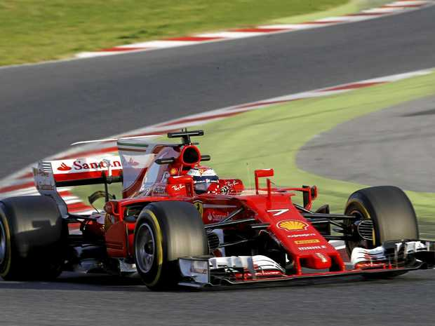 Ferrari driver Kimi Raikkonen takes a curve during a Formula One pre-season testing session at the Catalunya race track.