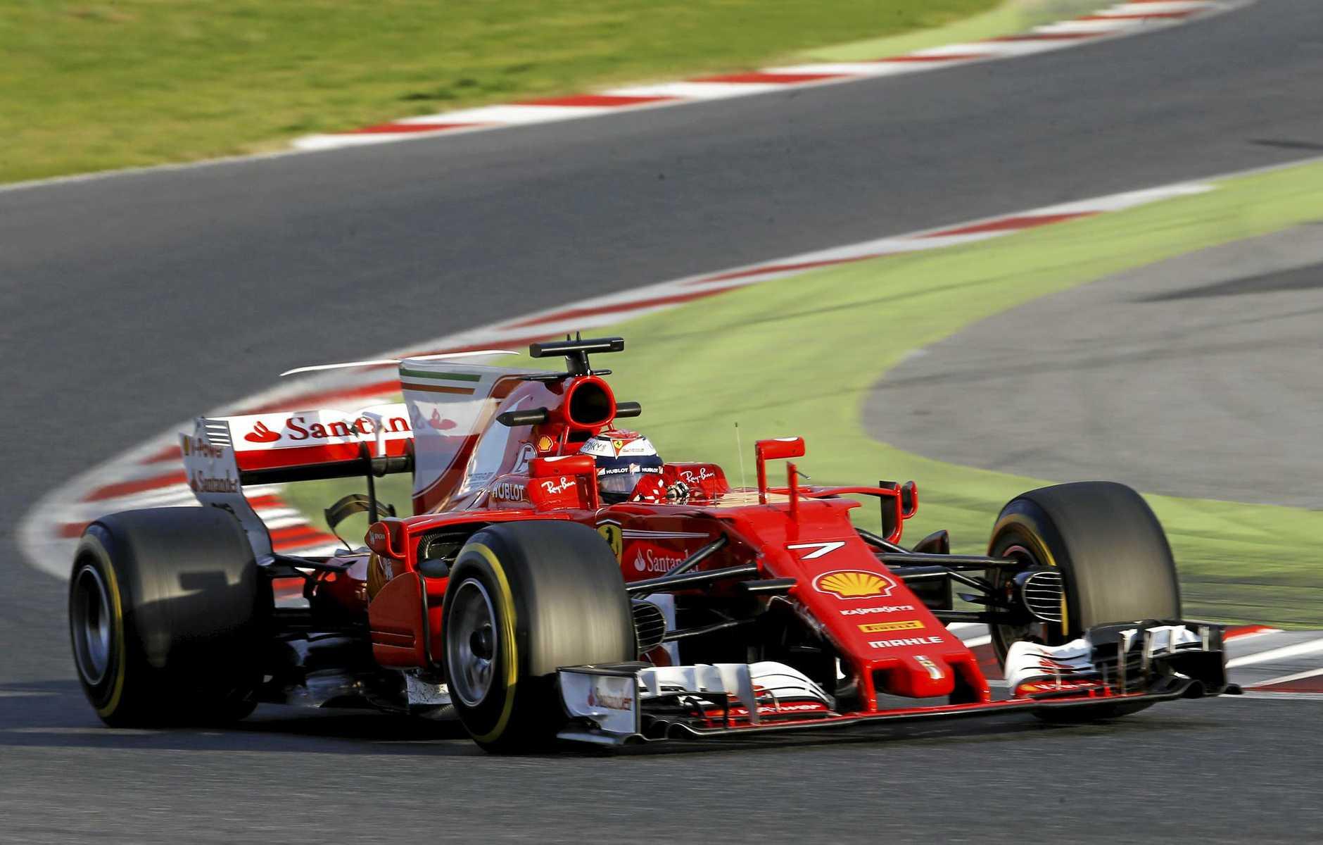 Ferrari driver Kimi Raikkonen takes a curve during a Formula One pre-season testing session at the Catalunya race track.