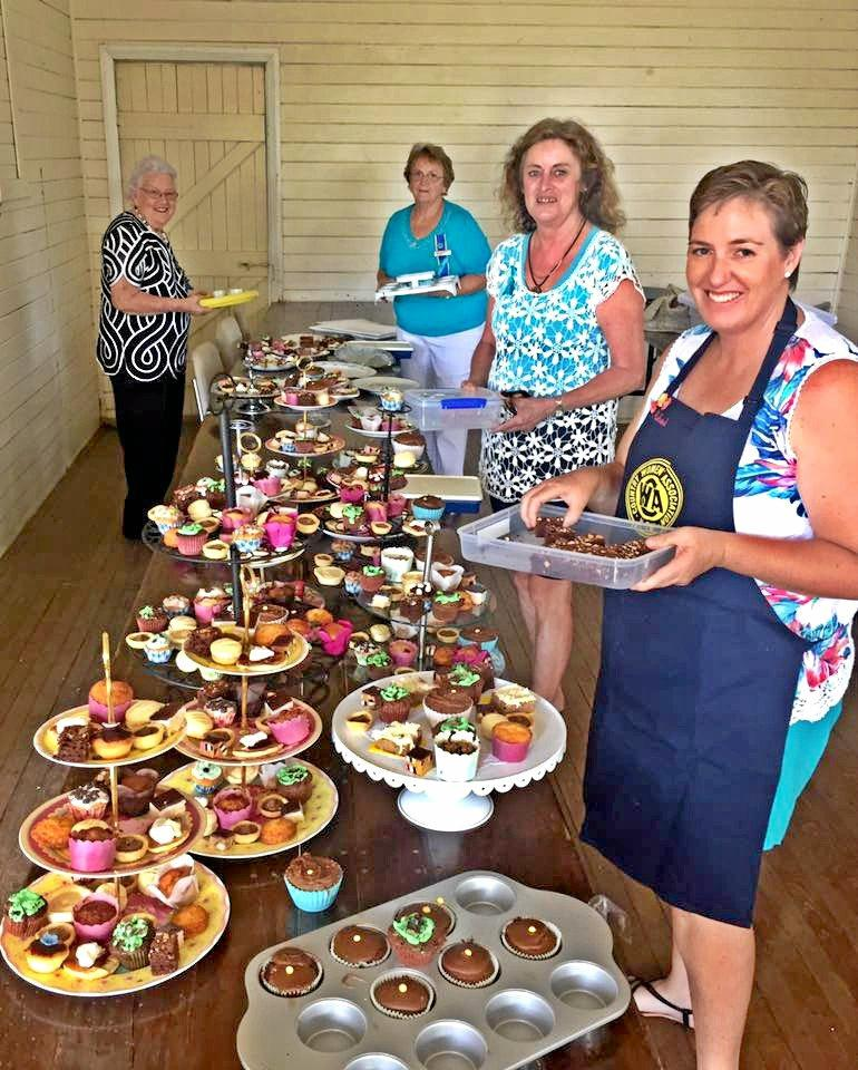CWA Old Benalbo branch members Joan Coonan, Kay Crocket, Liz Hughes and Racheal Newton serve up cakes at the Afternoon High Teal to raise funds for ovarian cancer research.