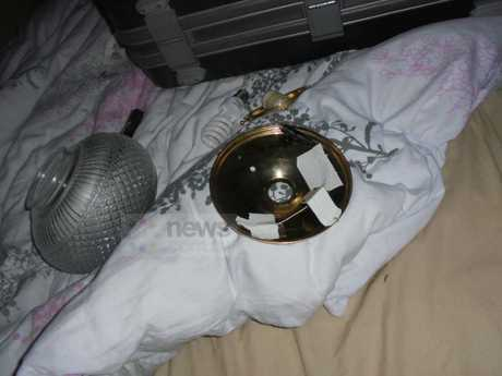 Exclusive photos show the camera hidden inside the ceiling light of the main bedroom rented by a Japanese girl and her husband while Imaeda spied on them. Picture: NSW PoliceSource:news.com.au
