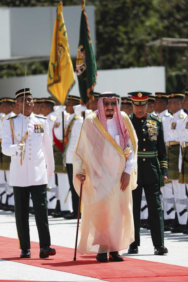 Saudi Arabia's King Salman, center, inspects an honor guard during a welcoming ceremony at Parliament House in Kuala Lumpur, Malaysia Sunday, Feb. 26, 2017. Salman is on four-day official visit to Malaysia. (AP Photo/Vincent Thian)