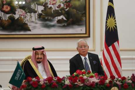 Saudi King Salman, left, sits together with Malaysian Prime Minister Najib Razak during the MOU signing ceremony in Putrajaya, Malaysia, Monday, Feb. 27, 2017. Salman arrived in Malaysia on Sunday to kick off a multi-nation tour aimed at boosting economic ties with Asia. (AP Photo/Vincent Thian)