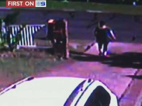 A neighbour runs down her driveway to help Tara Brown. Picture: Channel 9