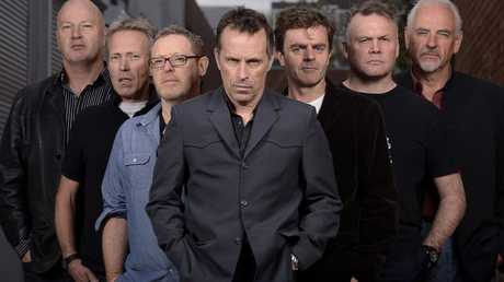Hunters and Collectors pose for portraits on 10th of September 2013 at Sing Sing Studio in Melbourne Australia.