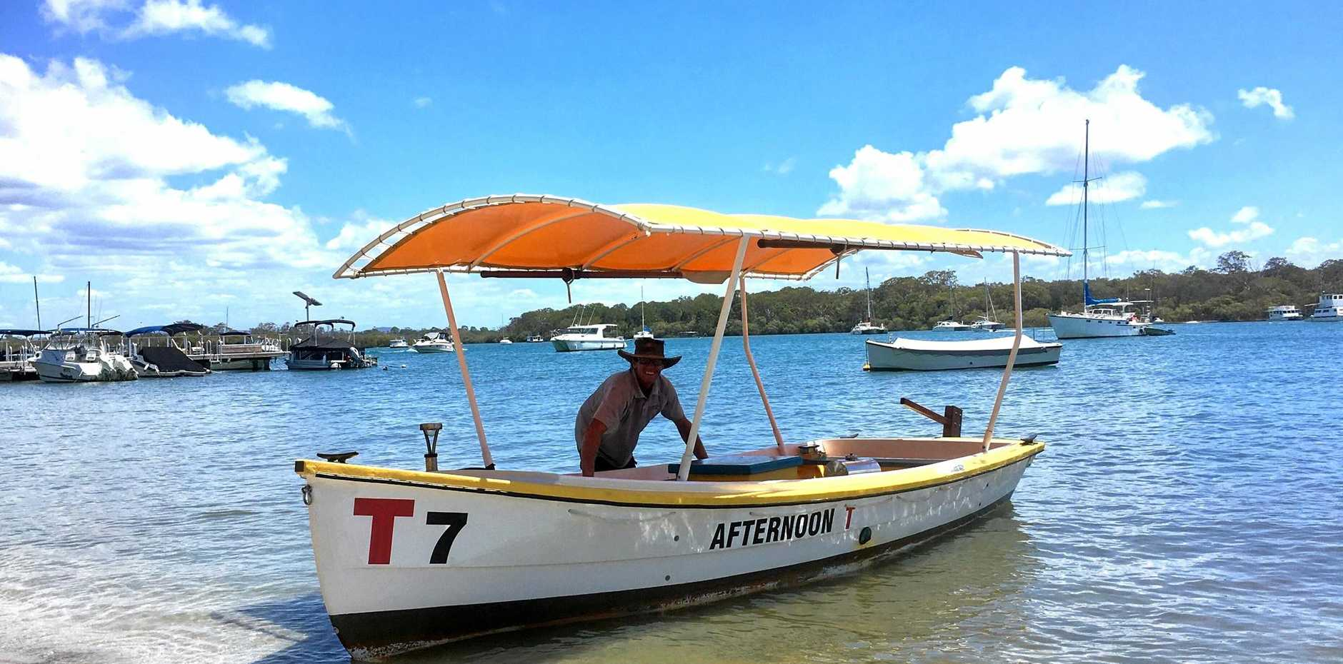 GOOD VIBRATIONS: Andrew Hosking with his restored T Boat on Noosa River.