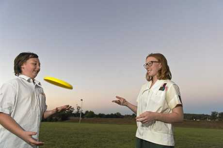Harry Chapman and Frances Wright play ultimate frisbee at Space Pilots at Rangeville Community Church, Friday, February 24, 2017.