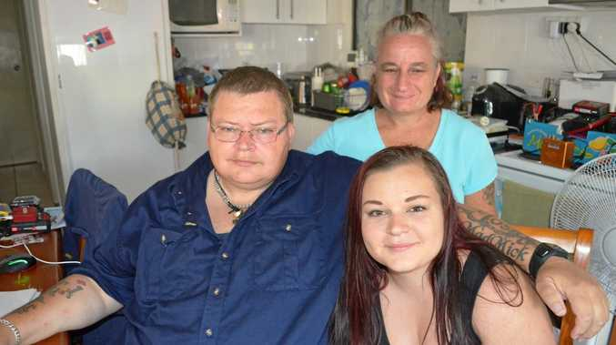 Darren Loss with his wife Iona and daughter Grace. Mr Loss found out in February 2017 he had an aneurysm. His brother died after an aneurysm burst just before his 21st birthday. Mr Loss hopes he can undergo surgery in Brisbane and Grace has started an online funding campaign to help the family with medical costs.