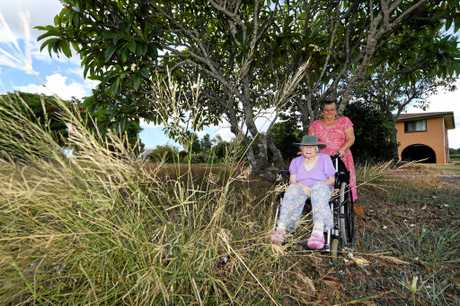 LONG GRASS: Joyce Lang and 99 year old mother on the nature strip outside her home in South Kolan.