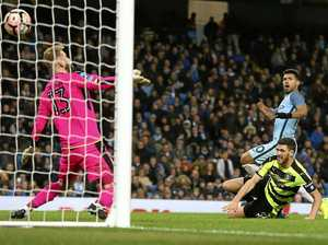 Aguero double puts City into last eight