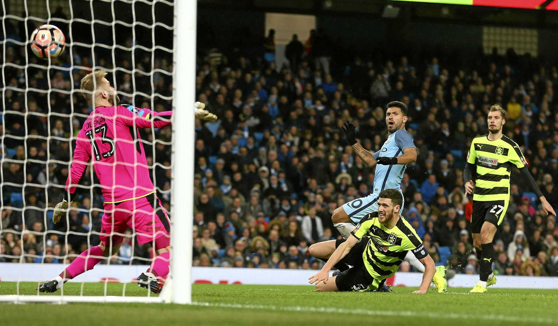 Manchester City's Sergio Aguero scores his side's fourth goal in the FA Cup win over Huddersfield.