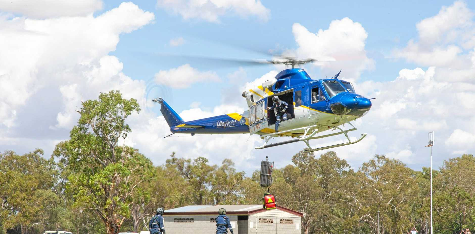 PREPARING FOR ACTION: The LifeFlight helicopter and paramedics along with QAS and The Queensland Fire Brigade ran a practice scenario.