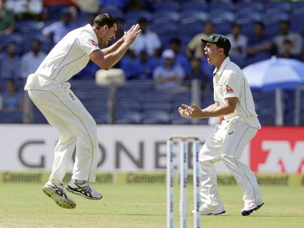 Australia's Mitchell Starc (left) celebrates the dismissal of India's captain Virat Kohli during the second day of the first Test in Pune.