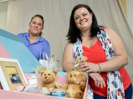 Precious Wings co-founder Kirstie Shaw (right) explains how the organisation provides special gifts for grieving families at the devastating time when they have lost a baby or child. Pictured with Ipswich Hospital clinical mid-wife Aynsley Hunter.