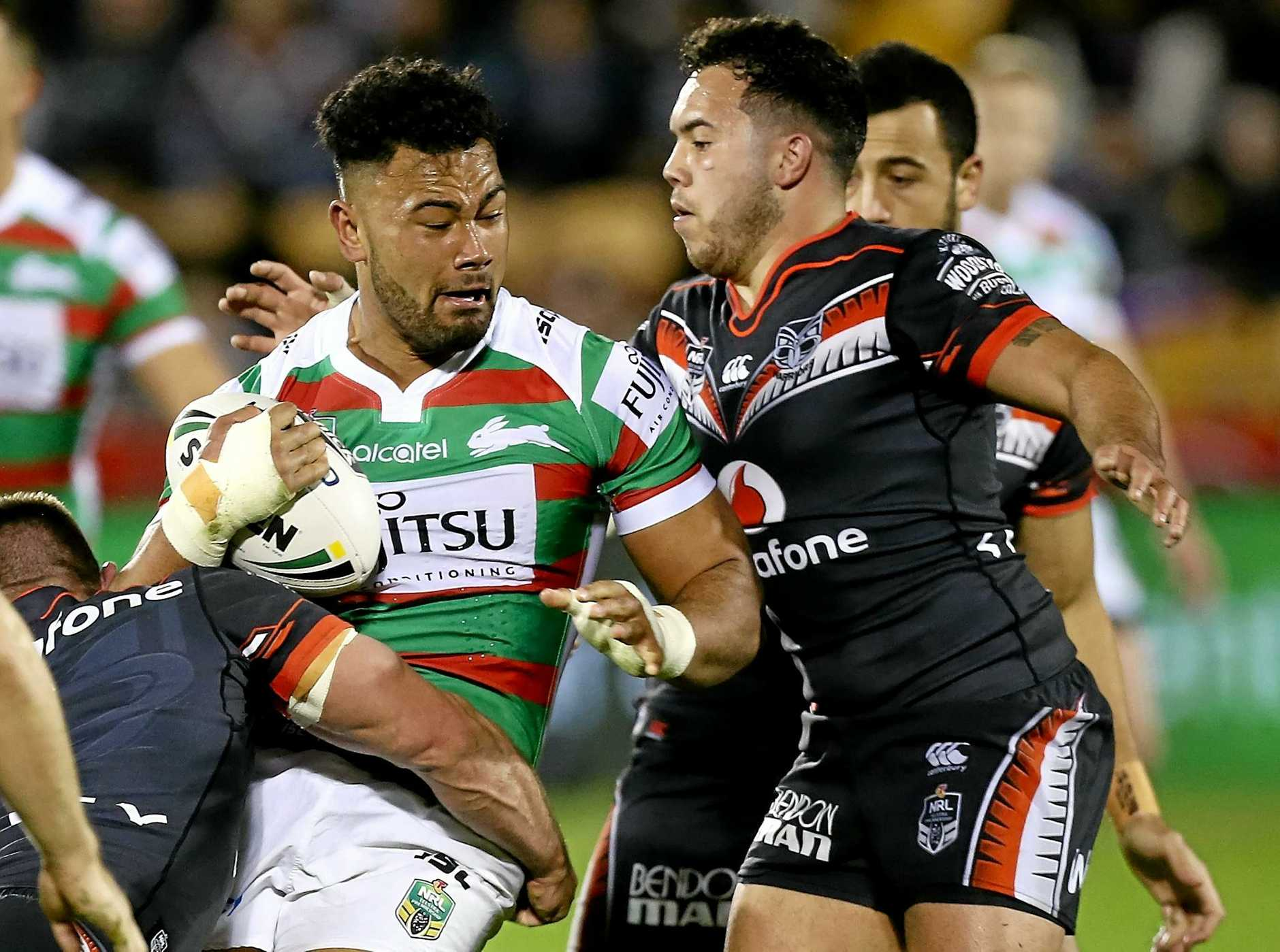 Zane Musgrove of the Rabbitohs prepares to be tackled by Jazz Tevaga of the Warriors.