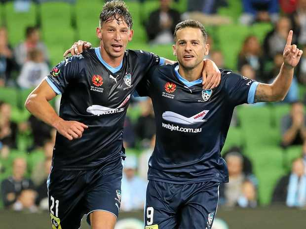 Sydney FC teammates Filip Holosko (left) and Bobo celebrate after a goal against Melbourne City.
