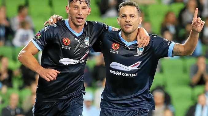 Sydney FC teammates Filip Holosko (left) and Bobo celebrate after a goal against Melbourne City.