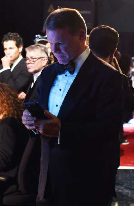 This previously unseen image of PwC accountant Brian Cullinan tweeting backstage ... a move that led to the Best Picture debacle. Picture: Splash Source:Supplied