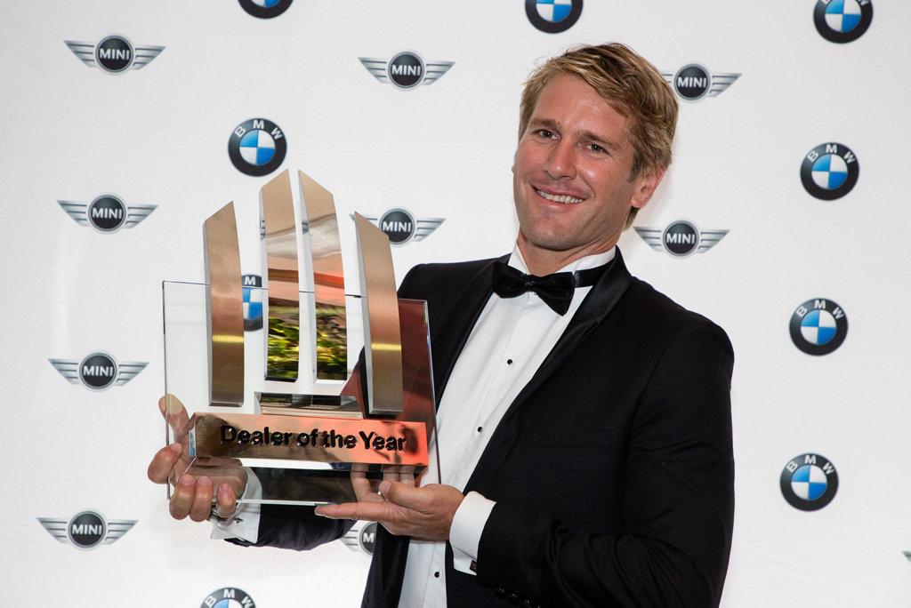 PROUD MOMENT: Coastline BMW's Tristan Kurz with the 2016 BMW Dealer of the Year award.