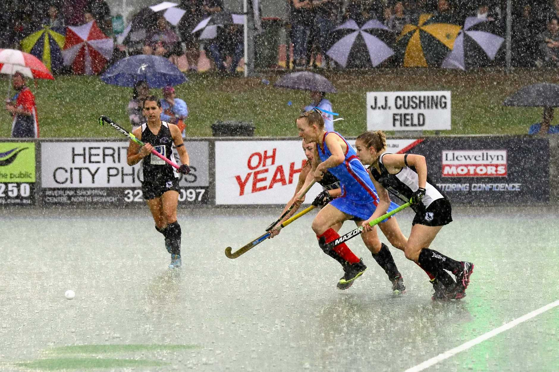 Swifts and Wests players battle through the rainy conditions in last year's A-Grade grand final at the Ipswich Hockey Complex.