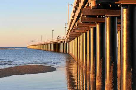 Sunset lights up Urangan Pier as we reach the shortest day of the year.Photo: Alistair Brightman / Fraser Coast Chronicle