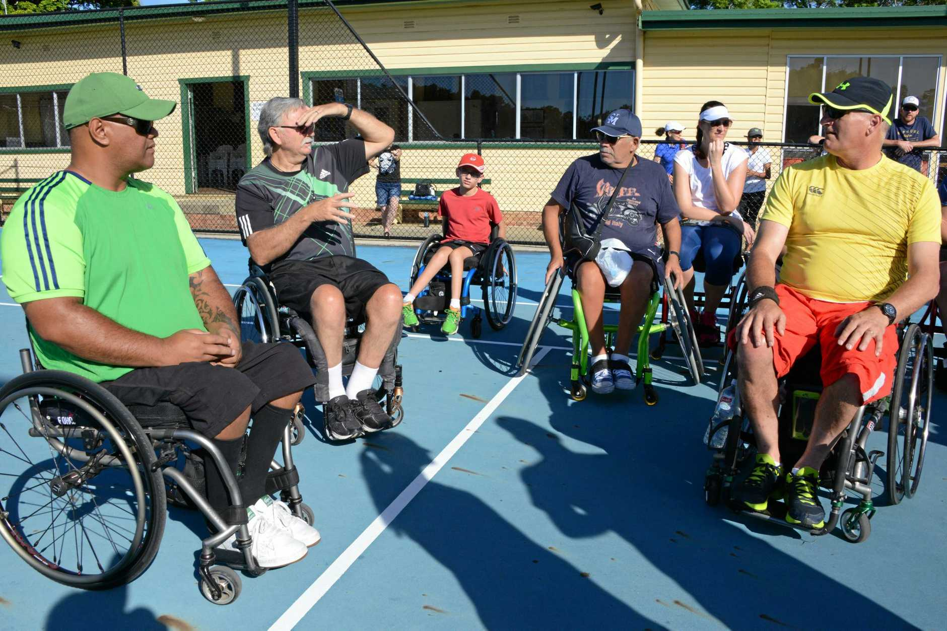 Action from the inaugural wheelchair tennis tournament at Grafton City Tennis Club.
