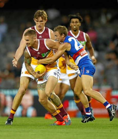 Dayne Beams tackled by Mitch Honeychurch  at Etihad Stadium