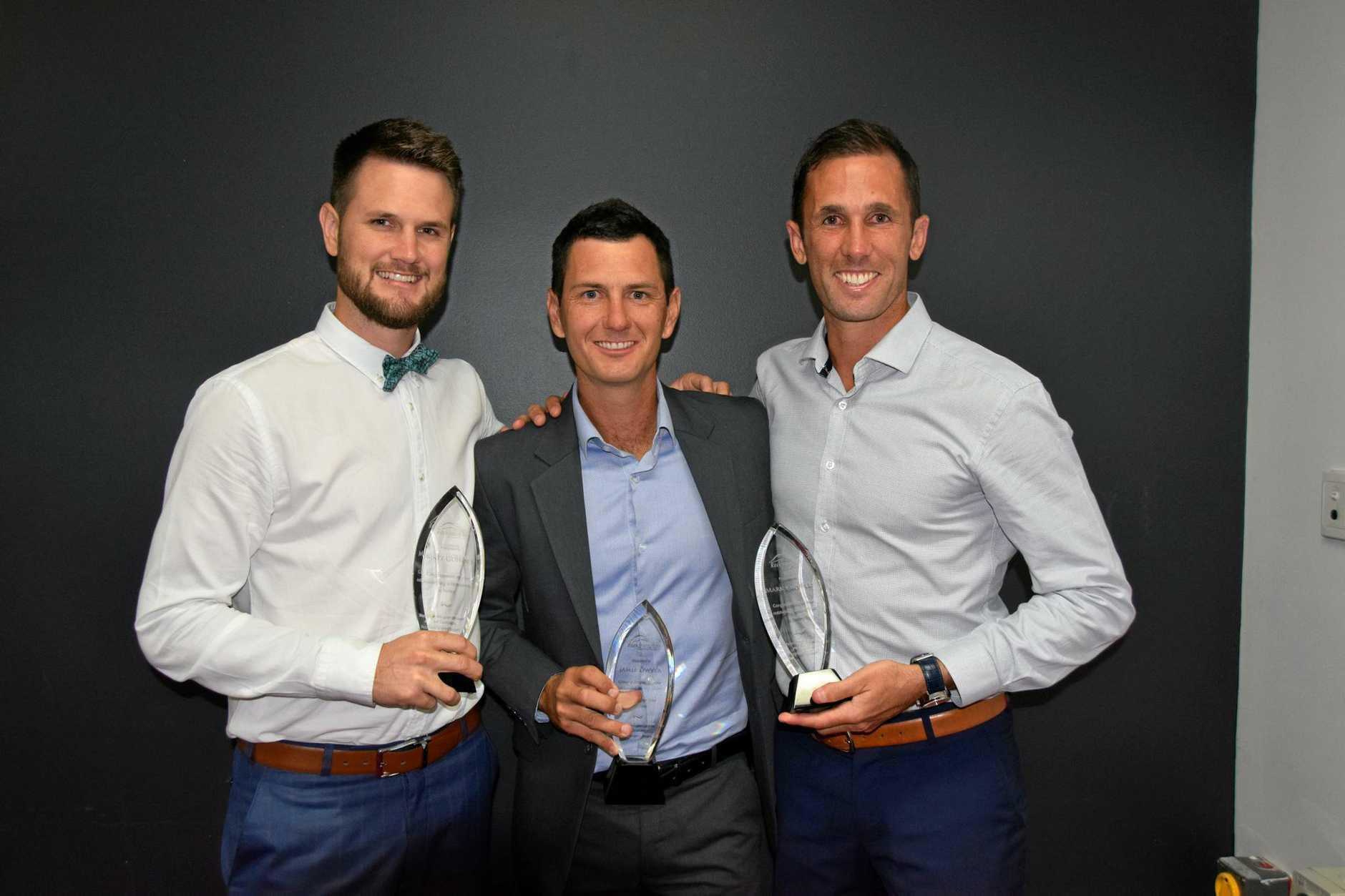 CHAMPIONS: Rockhampton hockey's finest, Matt Gohdes, Jamie Dwyer and Mark Knowles.