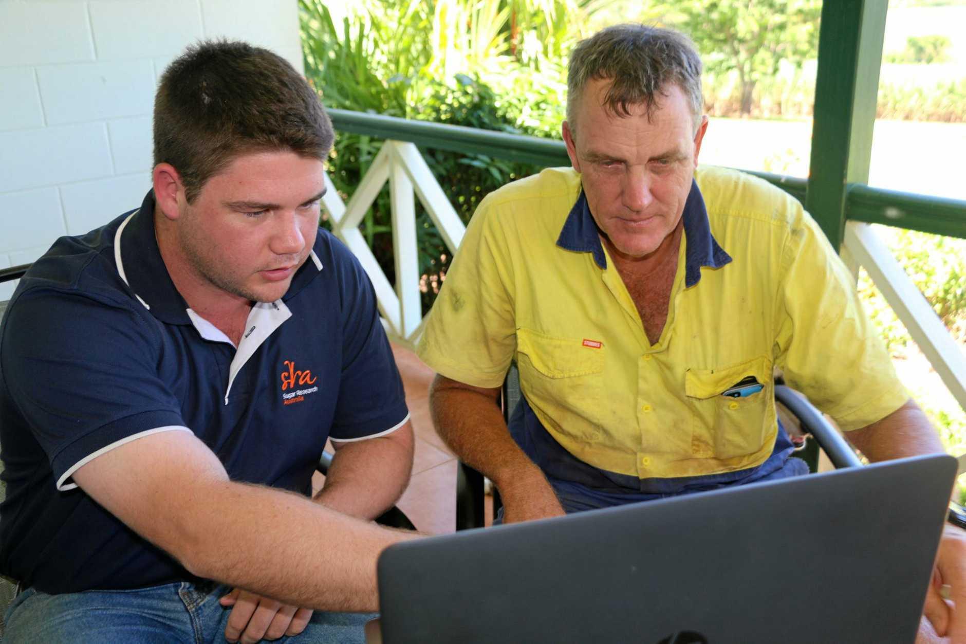 SRA adoption officer Gavin Rodman shows the FertFinder tool to Gordonvale grower Jeff Day.