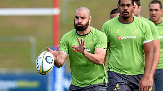 Wallabies player Scott Fardy catches a ball during Wallabies training in Brisbane
