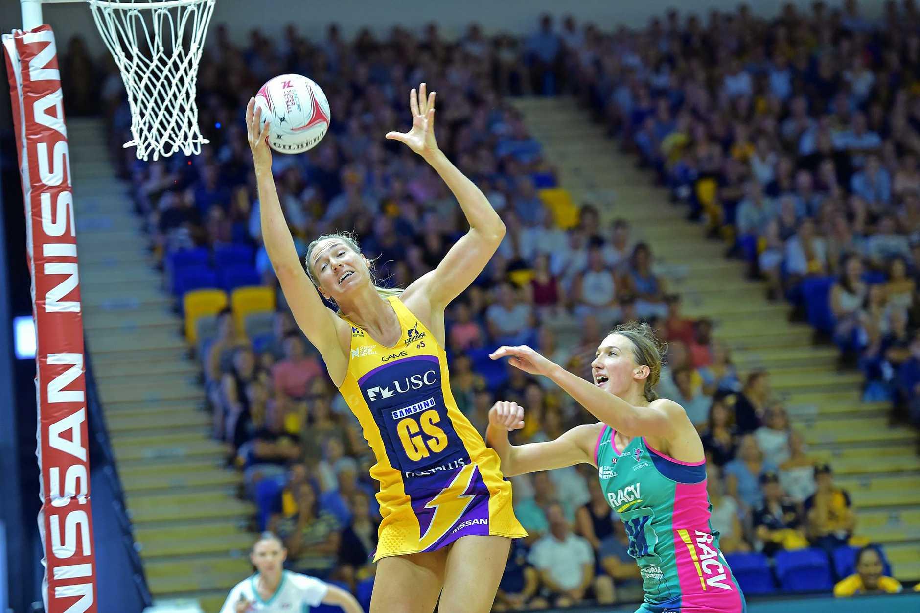 Sunshine Coast Lightning against Melbourne Vixens netball match at the University of the Sunshine Coast Sport Stadium.Lightning goal shooter Caitlin Bassett fights for the ball with Vixens Emily Mannix.