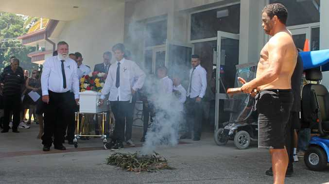 TRADITIONAL CEREMONY: A smoking ceremony is performed as Bundjalung Elder Aunty Bertha Kapeen's casket is taken out of Ballina's St Mary's Anglican Church on March 3.