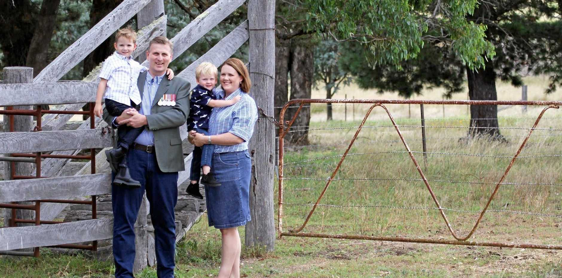 GIVE IT A GO: James Lister - with his wife Belinda and sons Jeremy, 6, and William, 3 - has been named the LNP candidate for the Southern Downs.