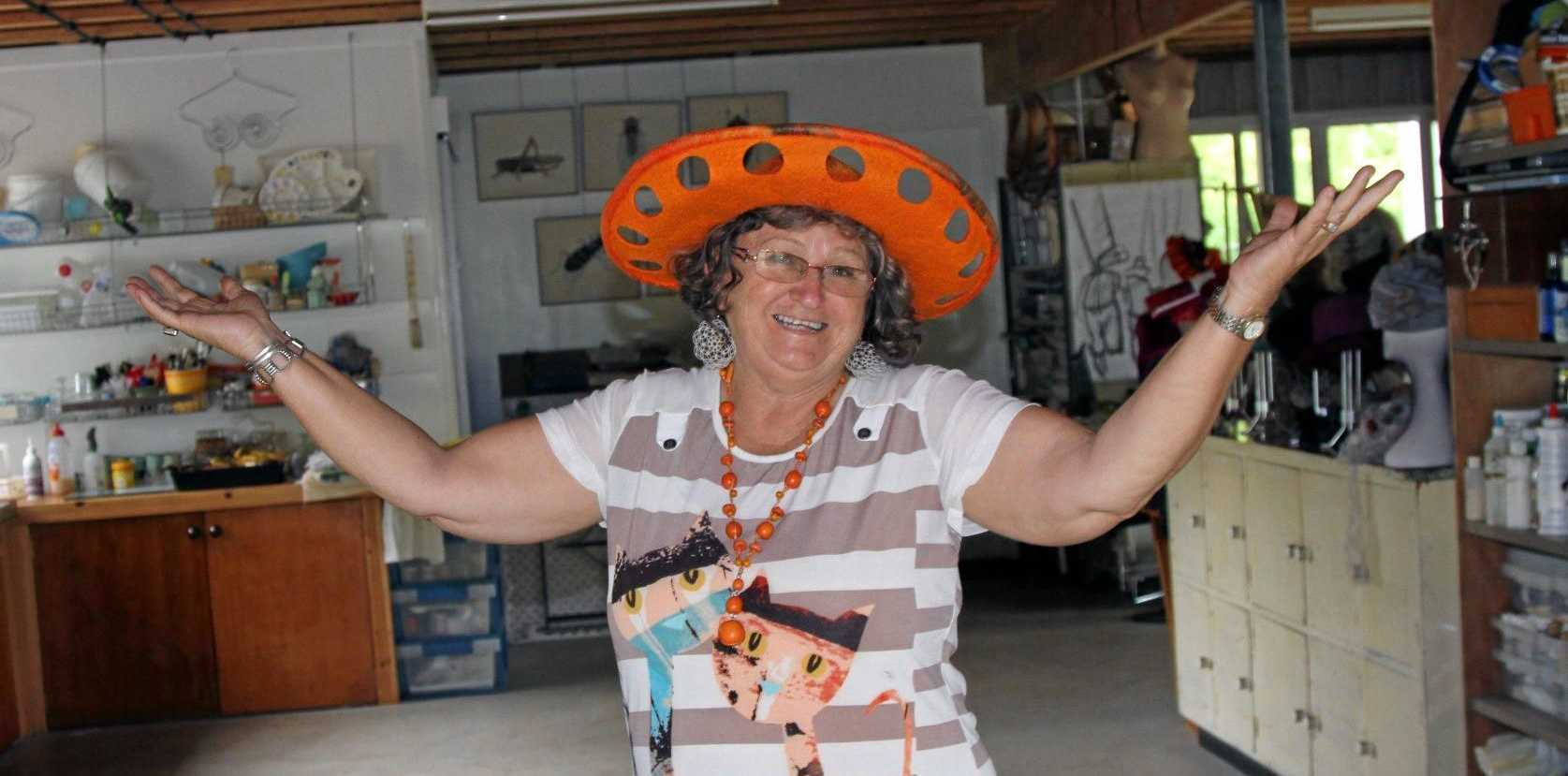 NOW AND THEN: Artist Rhonda Rettke models a felt hat inspired by an old tractor seat at the Gold Mining and Historical Museum as part of the exhibition Now and Then that explores contemporary historical stories.