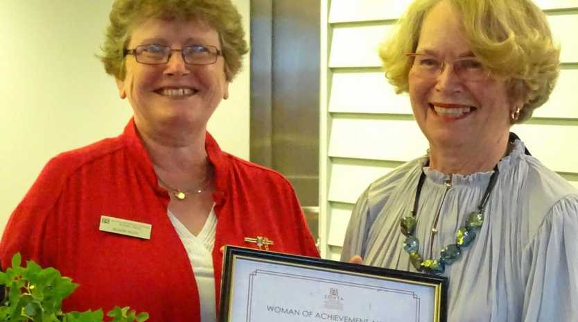 Zonta Club of the Blackall Range president Alison Huth presents Pam Marsden with the Woman of Achievement Award in 2016.