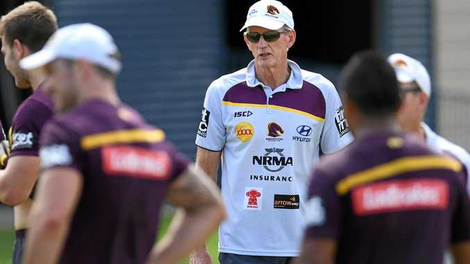 Brisbane Broncos coach Wayne Bennett talks to his players.