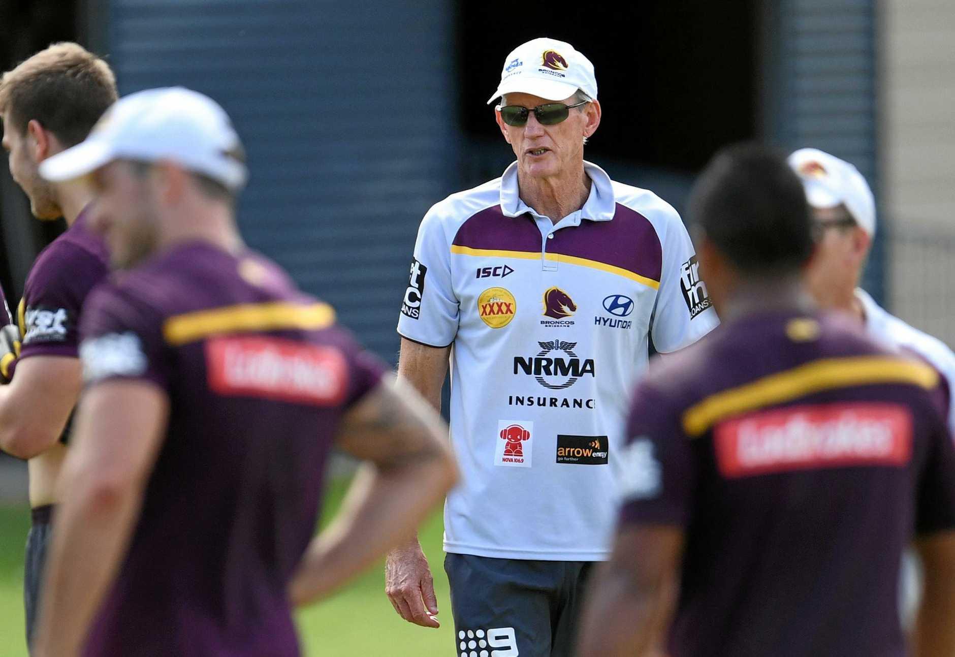 Brisbane Broncos coach Wayne Bennett talks to his players.