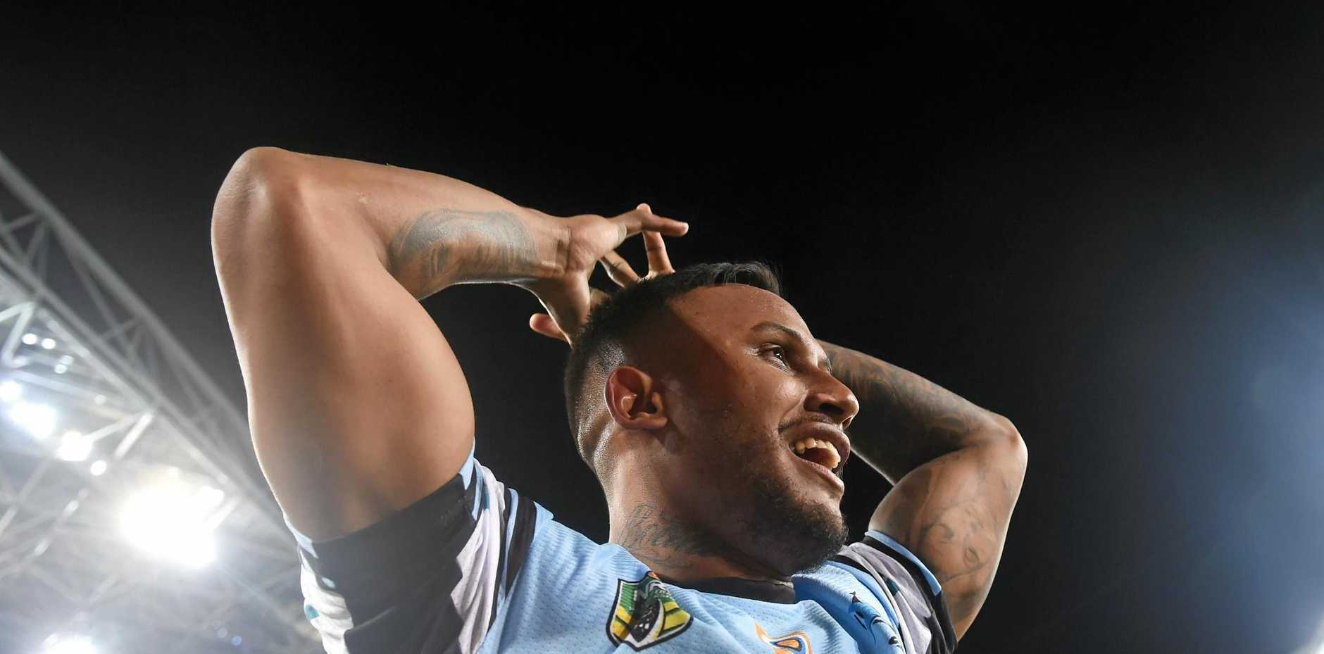 Ben Barba celebrates following the Sharks' win in the 2016 NRL grand final.