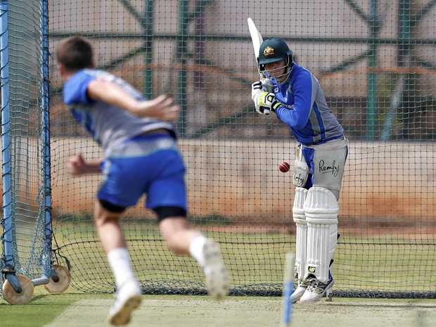 Australia's Jackson Bird bowls to captain Steve Smith in the nets in Bangalore.