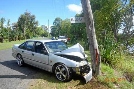 CRASH: The scene of a single vehicle collision on South Arm Rd, where the driver sustained a suspected fractured collarbone.