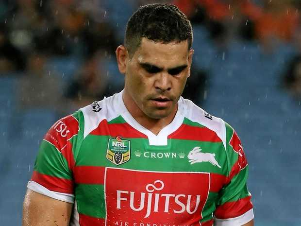 Greg Inglis of the Rabbitohs walks off injured against the Tigers.