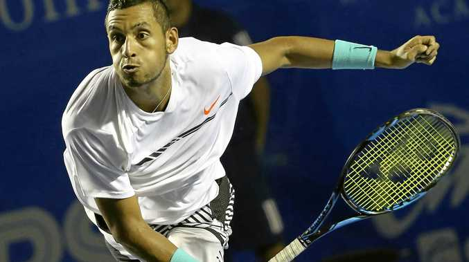 Australia's Nick Kyrgios serves to the United States' Sam Querrey at the Mexican Open in Acapulco.