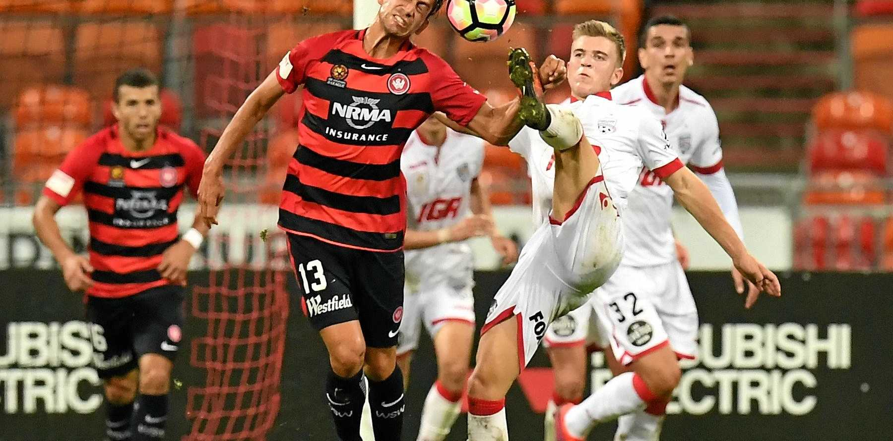 Bruno Piatares of the Wanderers tries for a header as United's Riley McGree tries to get his boot to the ball.