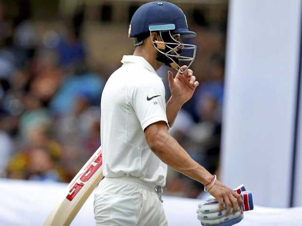 India captain Virat Kohli leaves the ground after losing his wicket during the first day of the second Test.