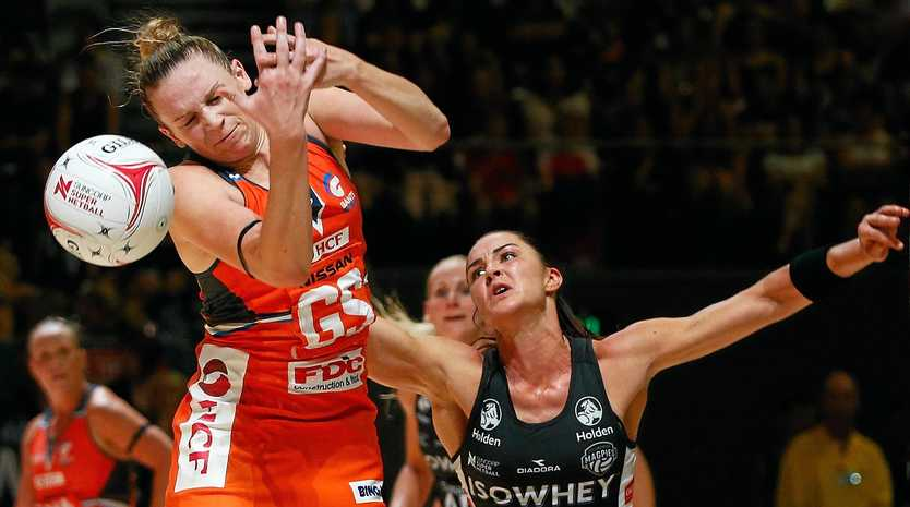 Sharni Layton of the Magpies (right) and Jo Harten of the Giants contest the ball.