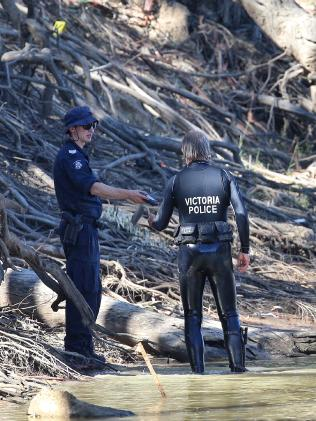 Victoria Police divers join the search. Picture: Hamish Blair