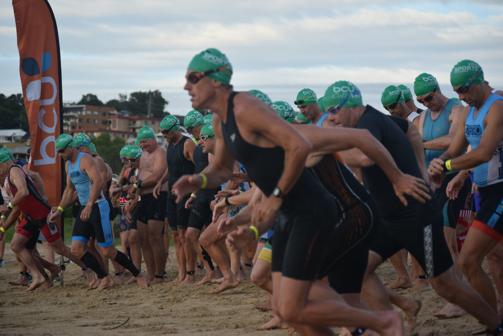 The men aged 45 and over head for the water as they start their bcu Coffs Tri morning. 5 March 2017 Coffs Harbour triathlon